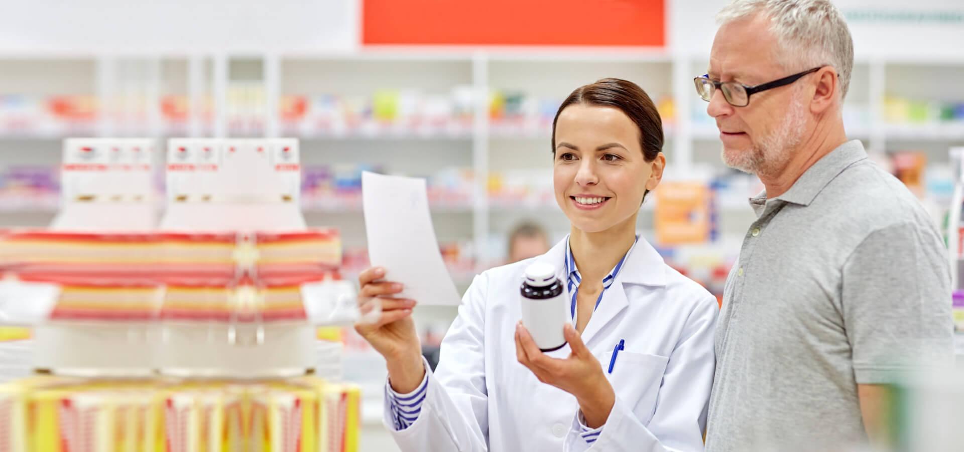 happy pharmacist and senior man customer