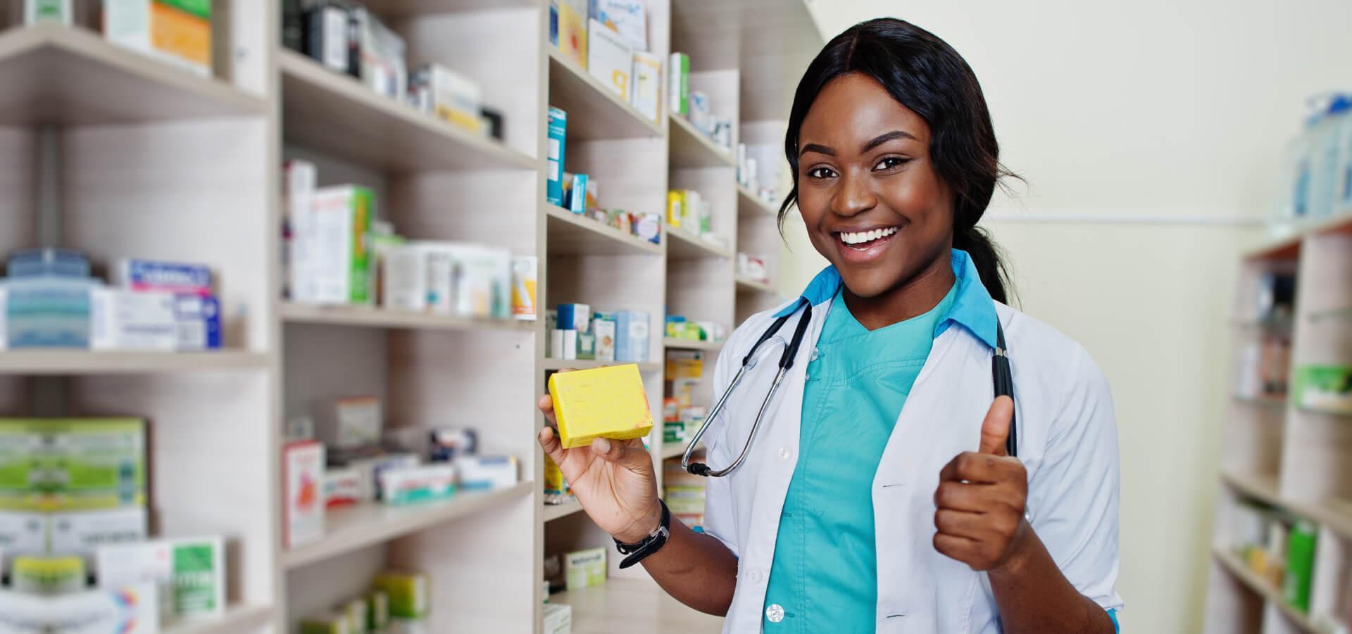 African american pharmacist working in drugstore