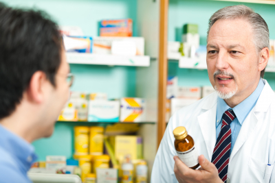 A customer asking for a medicine to a pharmacist