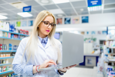 pharmacist searching for antibiotics on laptop